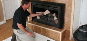 Man preparing a fireplace
